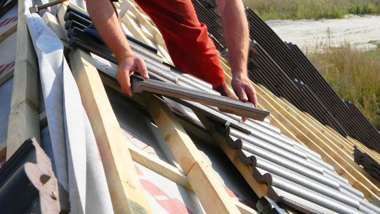 Roofing tiles being installed